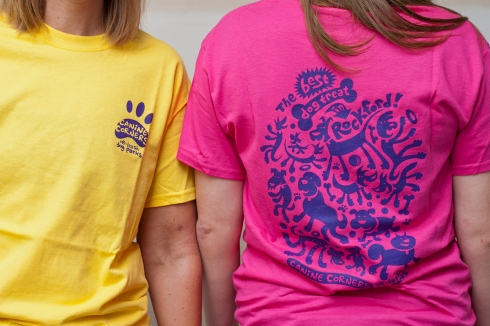 Canine Corners t-shirts in bright yellow and hot pink